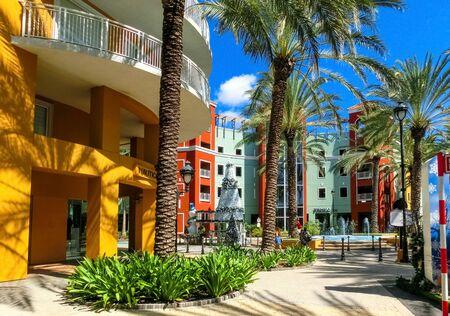 Willemstad, Curacao, Netherlands - December 5, 2019: Specific coloured buildings on Handelskade street in Curacao