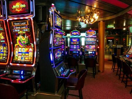 Half Moon Cay island, Bahamas - December 4, 2019: Casino interior, gaming slot machines, American gambling, cruise liner