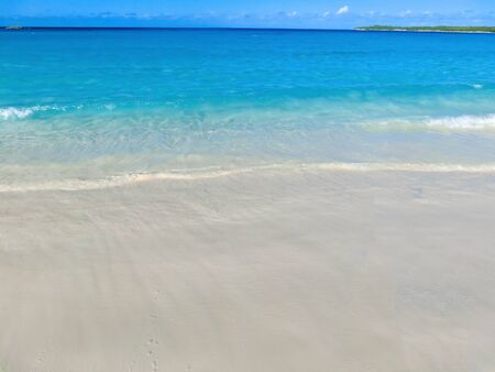 The view of beach on Half Moon Cay island at Bahamas. Blue water and white sand