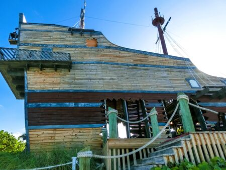 The original bar built in a shape of a pirate ship standing on Half Moon Cay island in The Bahamas. Banco de Imagens