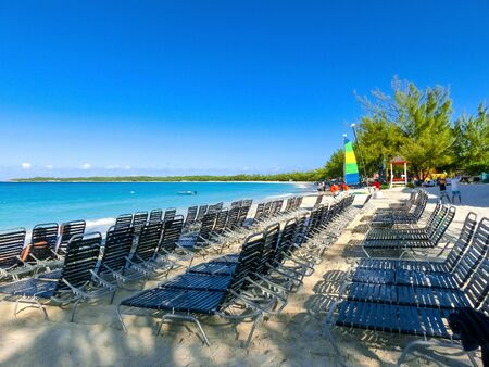 The view of empty beach on Half Moon Cay island at Bahamas. Blue water and white sand Banco de Imagens