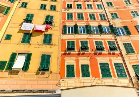 Colorful buildings at beach at Camogli on sunny summer day, Liguria, Italy Banco de Imagens