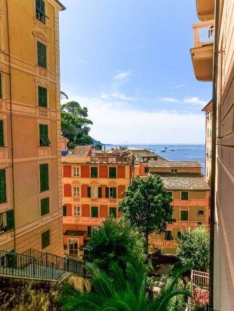 Colorful buildings and beach at Camogli on sunny summer day, Liguria, Italy