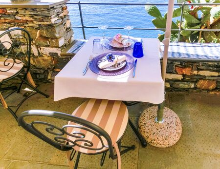 a wonderful view on open air cafe at Camogli on sunny summer day, Liguria, Italy