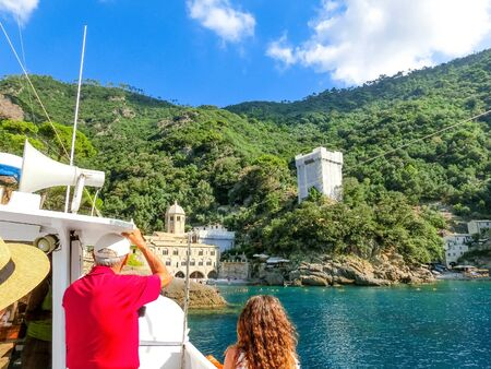 The scheduled boat passengers prepare for departure to San Fruttuoso abbey at Italy