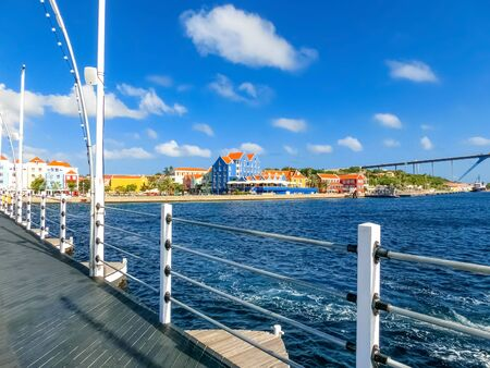 Queen Juliana Bridge Over Curacao. The Island Curacao is a tropical paradise in the Antilles in the Caribbean sea with beautiful architecture, beaches. Banco de Imagens