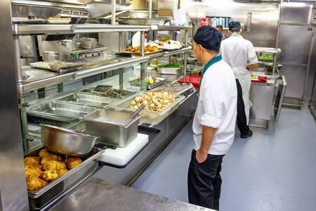 Kitchen crew work in the cruise ship in the Caribbean Sea