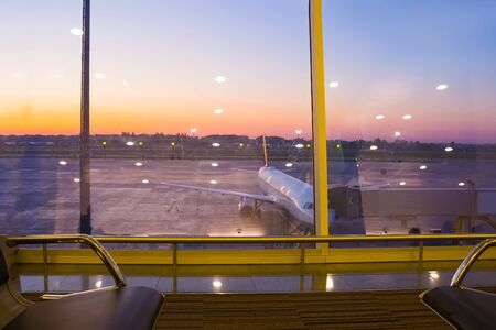 The window at departures hall at abstract airport. Stockfoto
