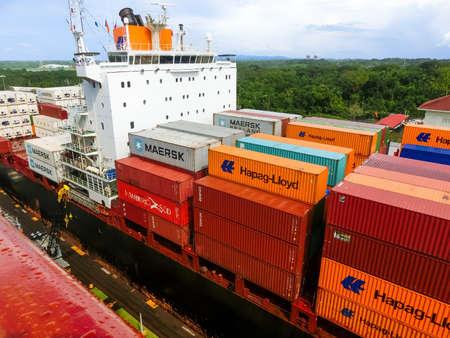 Panama Canal, Panama - December 7, 2019: Hapag-Lloyd cargo ship entering the Miraflores Locks in the Panama Canal, in Panama