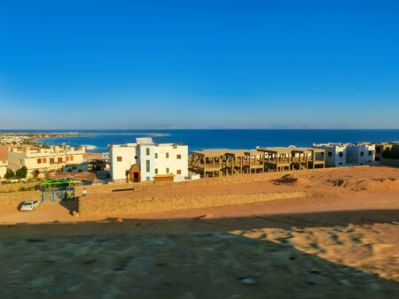 Panorama of the lagoon full of windsurfers in the town of Dahab, Egypt Stock Photo