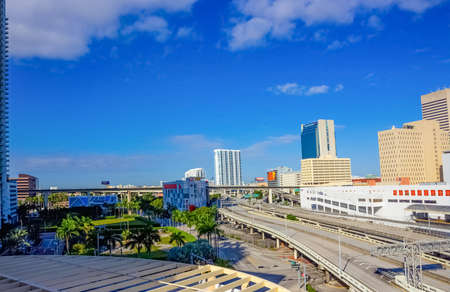 Miami, USA - November 30, 2019: Downtown Miami cityscape view with condos and office buildings against blue sky.