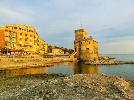 Rapallo, Italy - September 17, 2019: The italian castles on sea italian flag - castle of Rapallo , Liguria Genoa Tigullio gulf near Portofino at Italy at sunset.