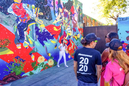 Miami, United States of America - November 30, 2019: Art Wynwood in Miami, USA. Wynwood is a neighborhood in Miami Florida which has a strong art culture presence and murals can be seen everywhere.