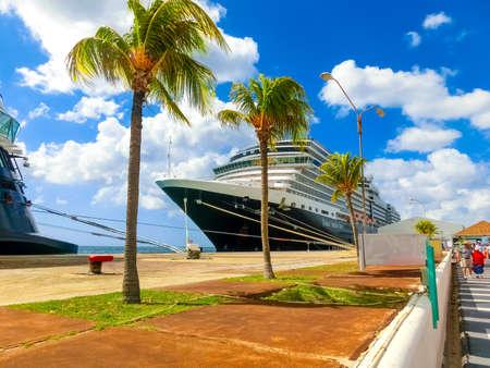 Oranjestad, Aruba - December 4, 2019: The people going near cruise ship Holland America cruise ship Eurodam docked at Aruba island. Editorial