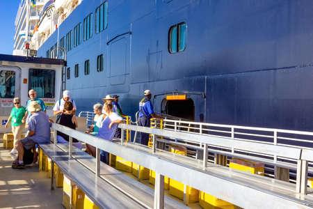 Half Moon Cay island, Bahamas - December 2, 2019: The people at tender boat from Holland America cruise ship Eurodam docked at sea near Bagamas Editorial