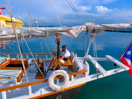 San Juan, Puerto Rico - May 08, 2016: Caribbean cruise ship and yacht anchored in the dock in San Juan, Puerto Rico