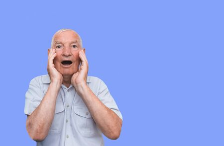 The old man with a emotions on a color studio background