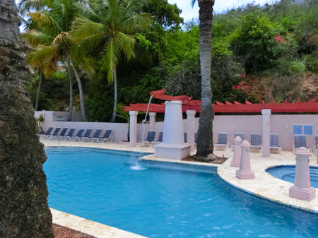 St. Thomas, US Virgin Islands - May 16, 2016: The pool at people at Marriott Frenchmans Cove resort at Caribbean tropical beach Morning Star Editorial