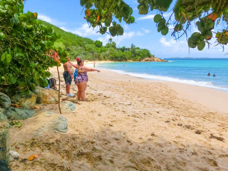 St. Thomas, US Virgin Islands - May 16, 2016: The people at Caribbean tropical beach Morning Star Marriott Frenchmans Cove resort. Editorial