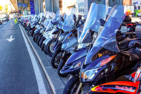 Genoa, Liguria, Italy - September 11, 2019: The motorcycle parking in the central street in the city center Editorial