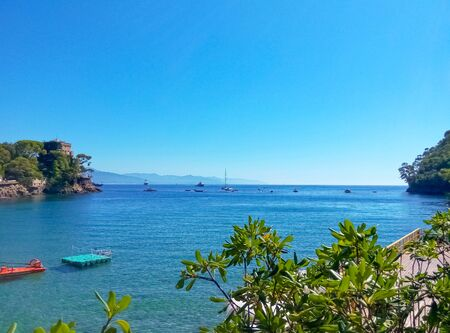 The beach known as paraggi near portofino in genoa on a blue sky and sea background