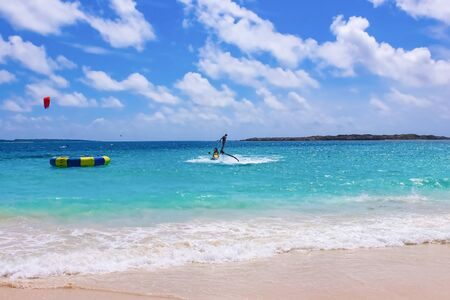 The new spectacular extreme sport called flyboard at Caribbean tropical beach
