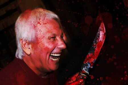 Portrait of crazy smiling senior man with knife. The halloween, murderer concept