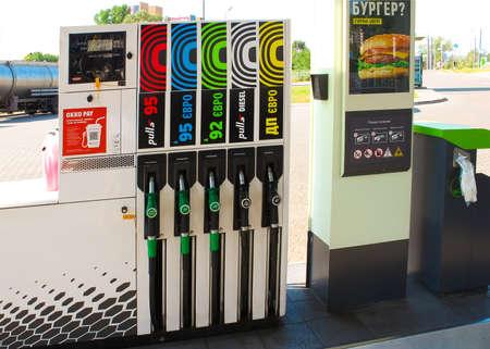 Kyiv, Ukraine - June 28, 2020: Filling nozzles at OKKO gas station at sunny day at Kyiv, Ukraine on June 28, 2020.
