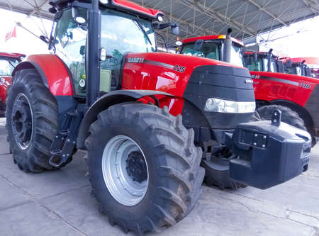 Kyiv, Ukraine - August 2, 2020: Case IH tractor 225 and logo at Kyiv, Ukraine on August 2, 2020. Case IH is a brand of agricultural equipment