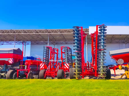 Large disc plow, towing for tractors to plow fields, against the sky Banque d'images