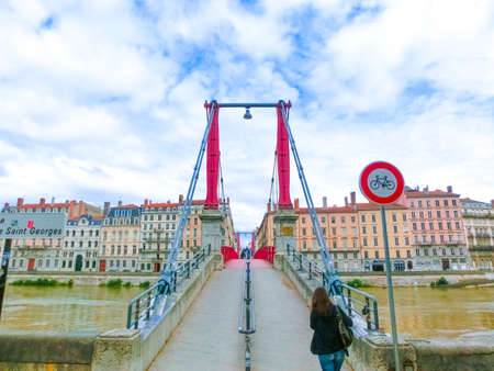 Bridge across river Rhone on winter sunny day, Lyon, France