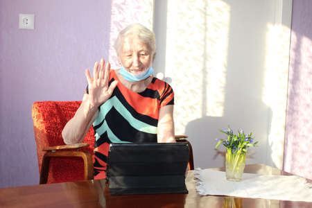 Stay connected. Happy senior woman at home video calling family on laptop or online chatting with long distance friends. Coronavirus lockdown, Hope, connections and technology concept.