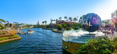 Orlando, USA - May 8, 2018: The panorama of Universal City Walk near the entrance of the Universal Studios theme park with large rotating Universal logo globe on May 8, 2018. Universal Studios is one of Orlando famous theme parks.