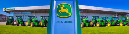 Kyiv, Ukraine - August 24, 2020: The Powerful tractors at John Deer store at Kyiv, Ukraine on June 16, 2020. Row of brand new John Deere tractors outside the store of local consortium, exhibition of latest agricultural machinery. Redactioneel