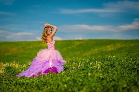 fantasize: Portrait of a beautiful blonde girl in a pink dress