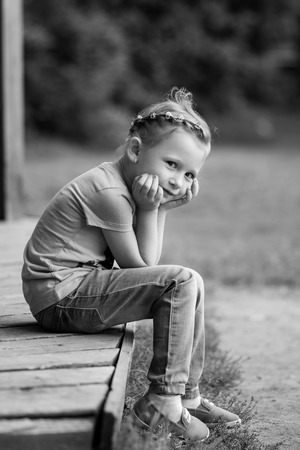 Cute and smilling little girl in the park in summer day Stock Photo