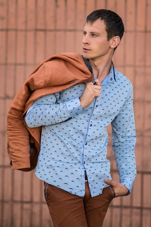 Cool fashion man in blue shirt. Staylish man