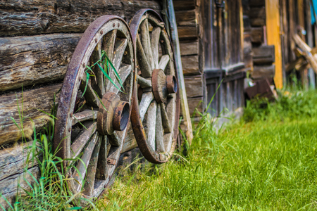 old wooden wheels in the village. summer Stock Photo