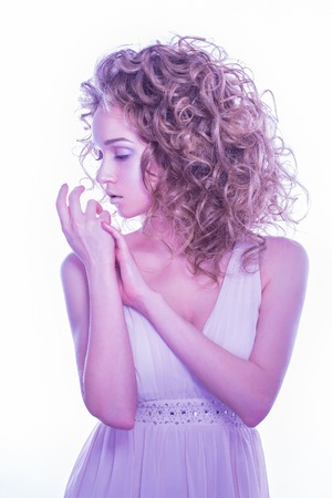 Fashionable and beautiful girl with curl hair. Perfect make-up