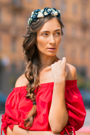 walk path: brunette model in red dress and walking on the street.