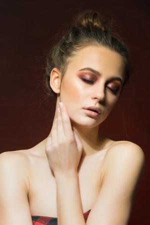 stilish: Wonderful woman portrait. Fashionable and stilish make-up. Red background.