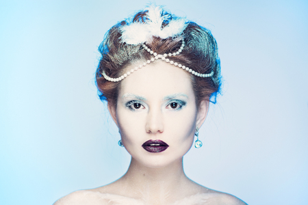 Snow Queen.Fantasy girl portrait. Winter fairy portrait.Young woman with creative silver artistic make-up.