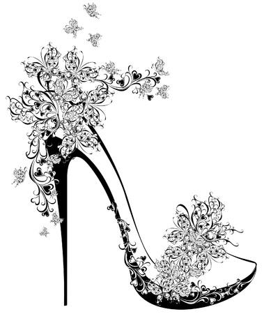 Zapatos en un alto talón adornado con flores y mariposas