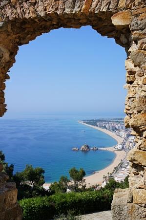 view through: Beach Blanes view through arch. Costa Brava, Catalonia, Spain