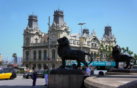BARCELONA - MAY 29: Lion monument and Barcelona Bus Touristic in Barcelona on 29 May 2012
