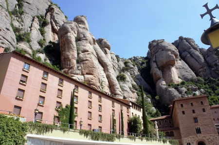 Montserrat Monastery is a beautiful Benedictine Abbey high up in the mountains near Barcelona, Catalonia, Spain  photo