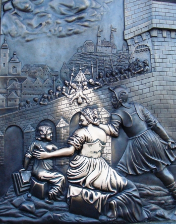 martyr: Close up relief with an execution scene of John of Nepomuk on Charles Bridge in Prague. The touch to it allows to come true to dreams.