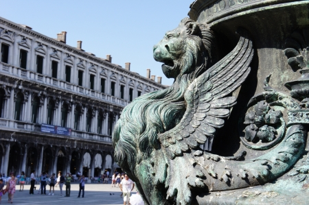 st mark's square: Detail of winged lion in flag mast on Piazza San Marco, Venice, Italy
