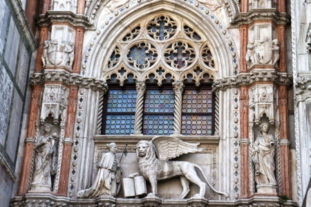 church window: Marble statues of  Venetian lion and Doge, San Marco cathedral, Venice