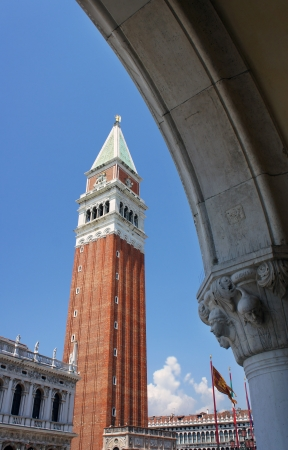 doge's palace: Saint Mark campanile seen through an arch of the Doges Palace on Saint Mark square in Venice, Italy